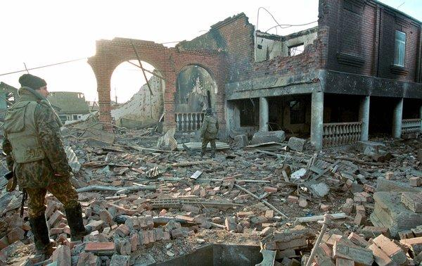 Chechen resentment over the brutality and destruction inflicted on their Caucasus republic still seethes years after the fighting subsided. In this scene from January 2000, Russian soldiers inspect the rubble left by their attack on the Chechen capital, Grozny.