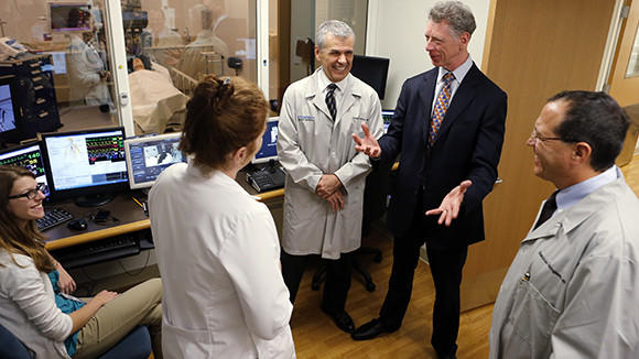 Dr. David Hayes (second from right), medical director of the Mayo Clinic Care Network, gets a tour of NorthShore Hospital's Sim Lab last September.