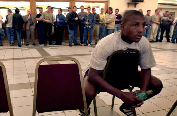 Leo Boxing Club fighter Lamar Fenner waits in the back of a Chicago Gaelic Park banquet room for his turn to box during the Grand Open Amateur Boxing Tournament in Oak Forest in 2002.