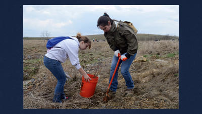 Tree planting volunteers from Penn State University Altoona branch included Catie Kilgus, left, and Ashley Wilmont.
