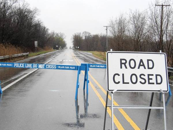 Wolf Road at 143rd Street was shut down by police Thursday due to flooding.