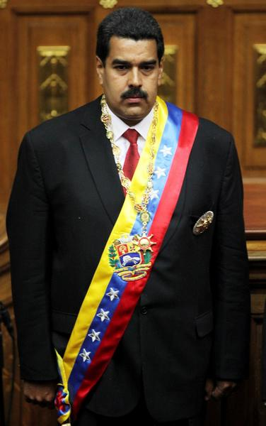 Venezuela's newly sworn-in President Nicolas Maduro pauses during the singing of the national anthem in the National Assembly in Caracas on Friday.