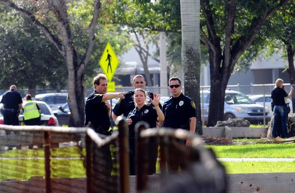 Plantation Police officers outside of South Plantation High school where a false report of a bomb prompted evacuation of the school around 8:30 a.m. for ninety minutes on Friday, a police spokesman said.