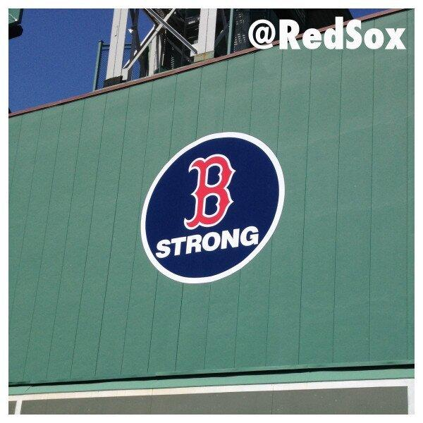 The Boston Red Sox show their support with a sign on the Green Monster wall in left field.