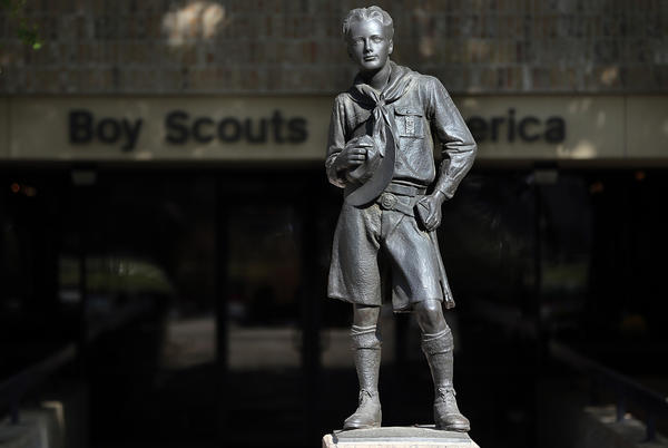 The Boy Scouts of America executive committee has put forth a resolution to lift the ban on gay members, to be voted on by the Scouts' National Council in May. Above, a statue of a Scout stands outside the BSA offices in Irving, Texas.