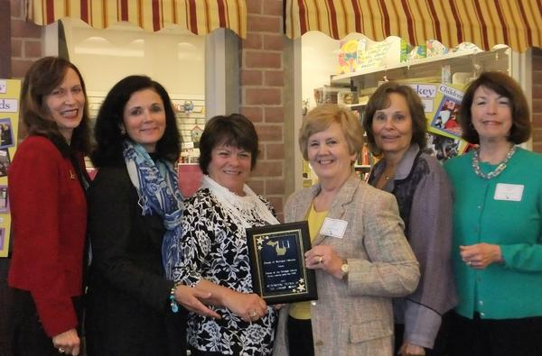 Board members from the Friends of the Petoskey Library celebrate after being presented the award for the top Friends organization in the state in the large library category at the recent state conference of the Friends of Michigan Libraries. From left to right are president Lauren Macintyre, past president Noreen Tarquini, second vice-president Mary Daniels, board member Anne Lewis, first vice-president Peg Pinho and board member Suzanne LaBeau. Library director Karen Sherrard also attended the award presentation. Other board members include secretary Ann Barfknecht, treasurer Joyce Hutto-Nolan, Jane Damschroder, Ann Ingles, Lynnet Johnson, Gayle Mroczkowski, Rhea Murray, Jan Smith and Carolyn Switzer.