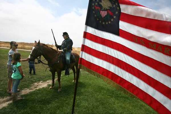 Steve Columbus and his horse, Ticonderoga, greet visitors to the Battle of Costa Mesa, a Civil War reenactment at Fairview Park, in 2009.