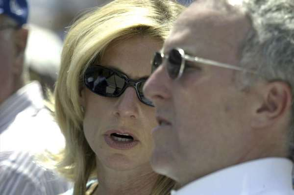 Former Dodgers owners Frank and Jamie McCourt watch a game at Dodger Stadium in April 2005.