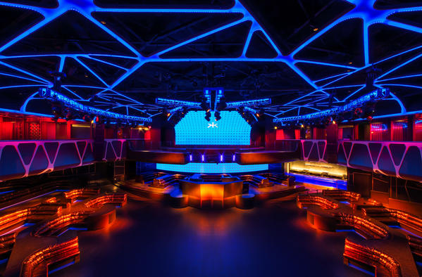 "The dramatically lighted Hakkasan Las Vegas includes a restaurant, a private dining room, the main nightclub, a mixology lounge and an ""Oriental Garden,"" equipped with its own DJ booth and bar."