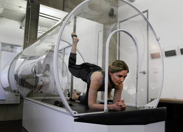 Trainer Brenda Papiernik demonstrates the heated exercise chamber at Iobella spa in Santa Monica.
