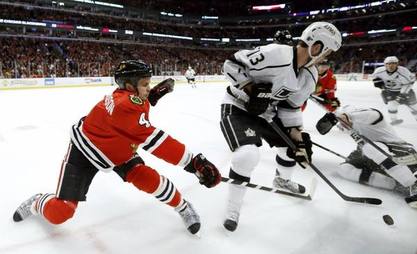 Chicago Blackhawks defenseman Niklas Hjalmarsson (4) battles Kings center Tyler Toffoli for a loose puck during a game on March 25.