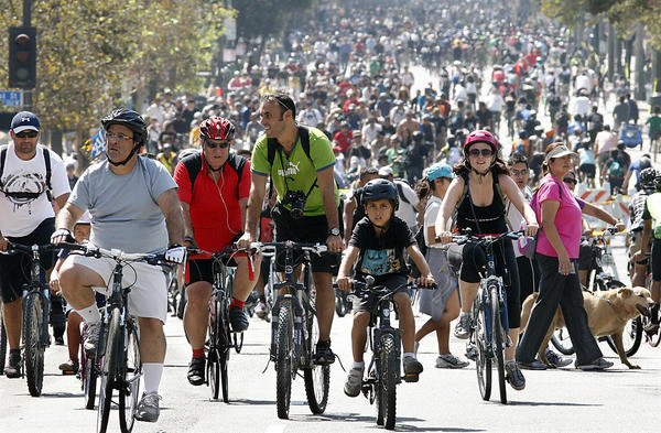 Thousands of bicyclists pedal up and down Spring Street in downtown Los Angeles during the 5th Annual CicLAvia on Oct. 7, 2012.