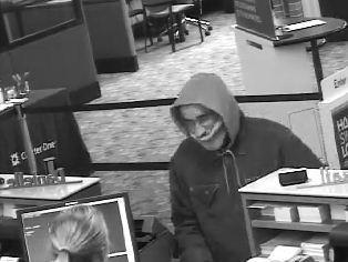 Rolling Meadows police released a surveillance photo of a man robbing a Charter One Bank.