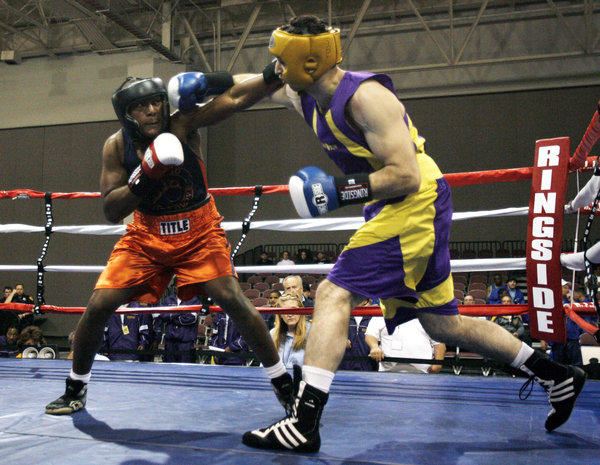 In this May 4, 2009 photo, Tamerlan Tsarnaev, right, fights during the 2009 Golden Gloves National Boxing Tournament.