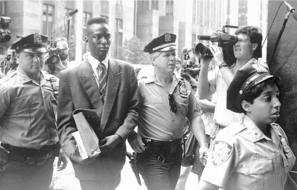 "Rapist suspect Yusef Salaam is escorted by police. Part of the Ken Burns documentary ""The Central Park Five."""