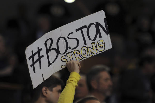 A fan holds a sign during the Boston Bruins game Wednesday.