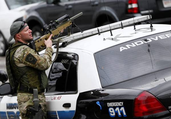 SWAT teams Friday conduct a house-to-house search in Watertown, Mass., as they look for Dzhokar Tsarnaev, the one remaining suspect in the Boston Marathon bombing.