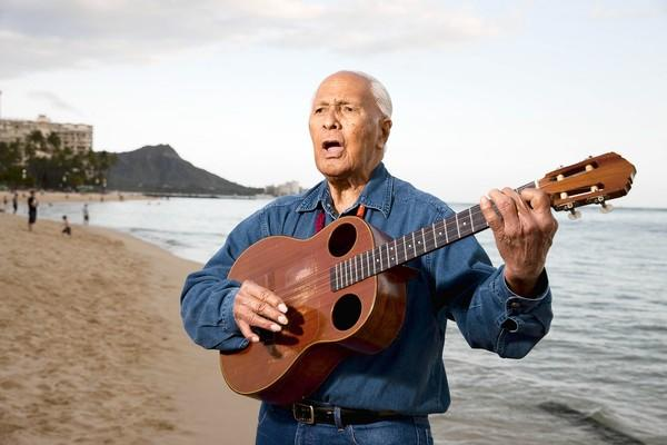 Ukulele legend Eddie Kamae plays a few songs on Waikiki Beach in Honolulu.