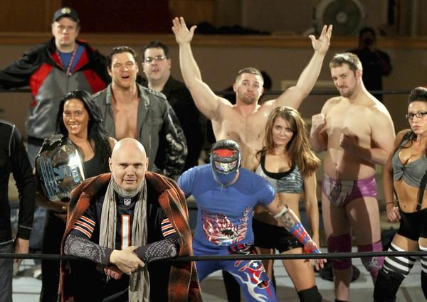 """Musician Billy Corgan (lower left), shown with some of the wrestlers from Resistance Pro before the """"Sad Wings of Destiny"""" event at Teamsters Auditorium, 328 S. Marshfield in Chicago, on Friday, November 30, 2012."""
