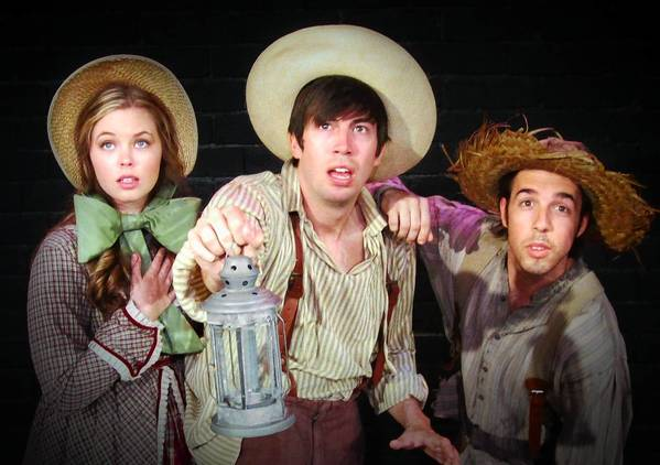 "Tom (Spencer Morrow, center) and joined by Becky Thatcher (Bella Muller) and Huck Finn (Mark Chandler) in ""The Adventures of Tom Sawyer."""