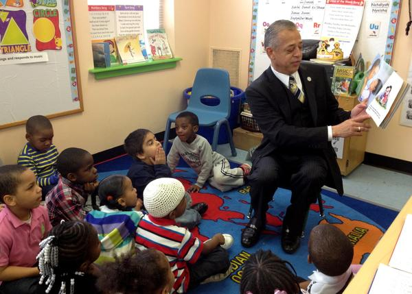 "Hartford Mayor Pedro Segarra reads to preschoolers at the Heritage Child Development Center on Enfield Street Friday. The book was ""My Body Belongs To Me"" by Jill Starishevsky."