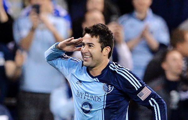 Sporting Kansas City's Claudio Bieler salutes the fans after scoring the only goal of the game against D.C. United in an MLS game earlier this month.