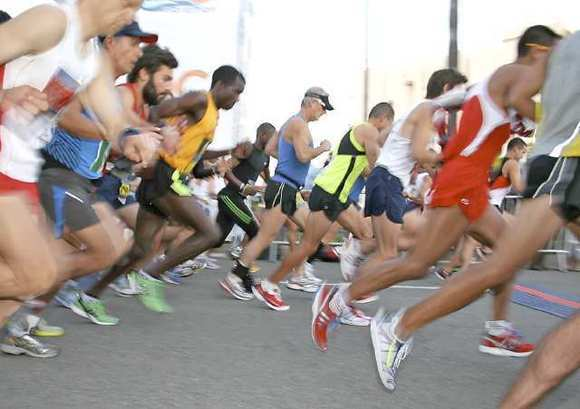 Runners take off from the starting line of the 2011 OC Marathon at Fashion Island in Newport Beach.
