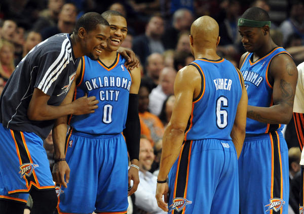 Oklahoma City's Kevin Durant, Russell Westbrook, Derek Fisher and Ronnie Brewer share a laugh during a timeout.