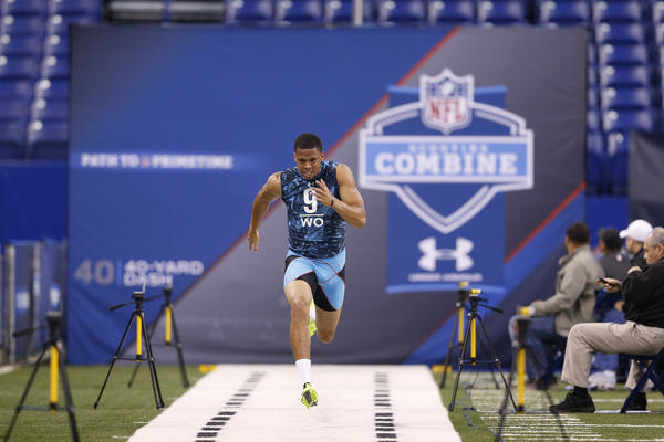 Corey Fuller of Virginia Tech runs the 40-yard dash during the NFL scouting combine at Lucas Oil Stadium.
