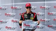 Matt Kenseth took the pole Sunday at one of his favorite places after setting a track qualifying record of 191.864 mph at Kansas Speedway.
