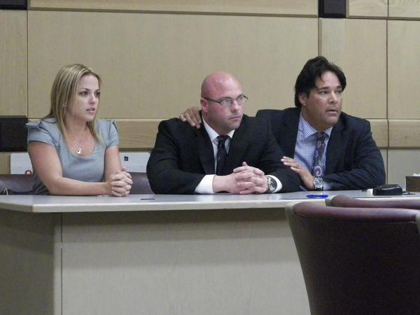 Broward Sheriff's Deputy Jerry Wengert (center) and defense lawyers Marla Chicotsky (left) and Eric Schwartzreich (right) await jury's verdict in Wengert's official misconduct and battery trial. The jury found Wengert not guilty.