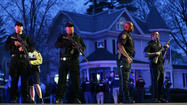 WATERTOWN, Mass. (AP) - A 19-year-old Massachusetts college student wanted in the Boston Marathon bombing was captured hiding out in a boat parked in a backyard Friday and his older brother lay dead in a furious 24-hour drama that transfixed the nation and paralyzed the Boston area with fear.