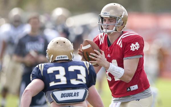 South Bend Tribune/ROBERT FRANKLIN Notre Dame quarterback Tommy Rees takes turns at quarterback during Friday's practice at the Miami Dolphins training facility in Davie, Fla., December 4, 2013 in preparation for the national championship game.