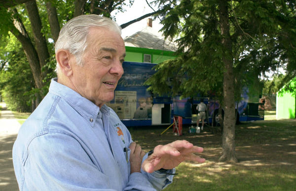 Al Neuharth talks in front of the Freedom Forum's bus in Eureka in this 2002 AP file photo. Neuharth, on a national tour at the time, wanted his children to see his hometown of Eureka. He said in 2002 that he tried to get back four times a year, including a fall trip for the pheasant hunting season. Neuharth died in Cocoa Beach, Fla., Friday. He was 89. Associated Press photo by Doug Dreyer