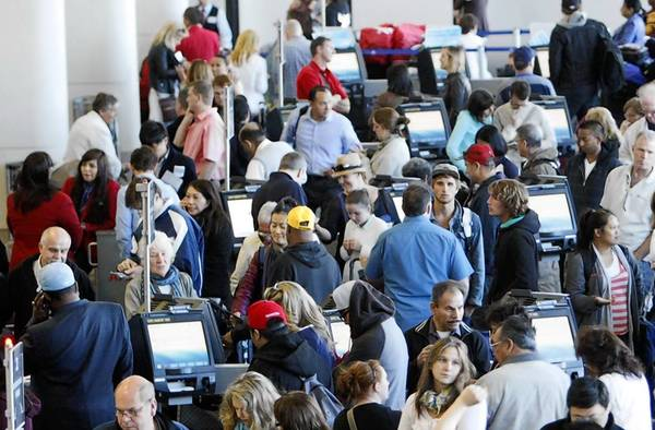 Passengers crowd American Airlines' Terminal 4 at Los Angeles International Airport this week because of a problem with the airline's computer system.