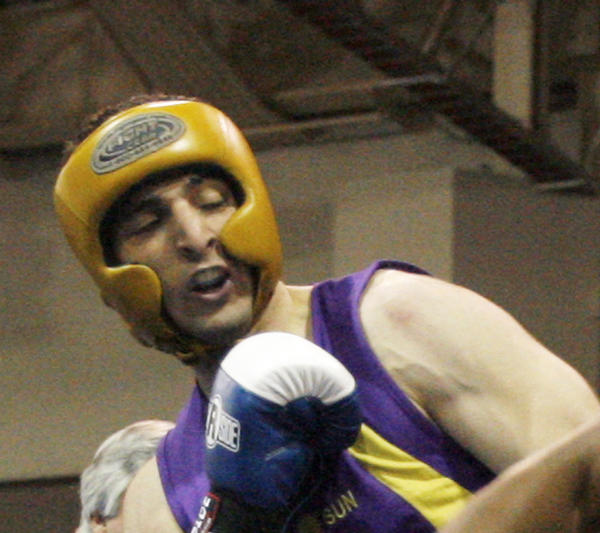 In this May 4, 2009 photo, Tamerlan Tsarnaev, left, fights during the 2009 Golden Gloves National Boxing Tournament.