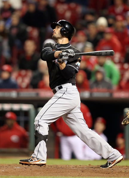 CINCINNATI, OH - APRIL 19: Justin Ruggiano #20 of the Miami Marlins hits a game winning home run in the ninth inning during the game against the Cincinnati Reds at Great American Ball Park on April 19, 2013 in Cincinnati, Ohio. The Marlins won 2-1. (Photo by Andy Lyons/Getty Images) ORG XMIT: 163493204