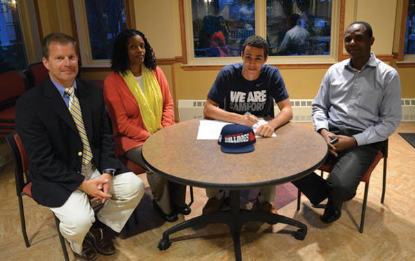 Saint James senior Nnamdi Enechionyia, third from left, signed his letter-of-intent to play basketball at Samford University, an NCAA Division I school. At the signing ceremony are Saints athletic director Jim Fahey and Enechionyia's mother Brenda, left, and father Brunchie.