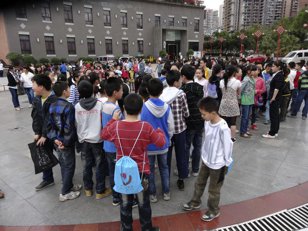 Students gather outside a school in China's Sichuan province after an earthquake April 20. A large temblor struck the province Saturday morning, kiilling at least 28 people.