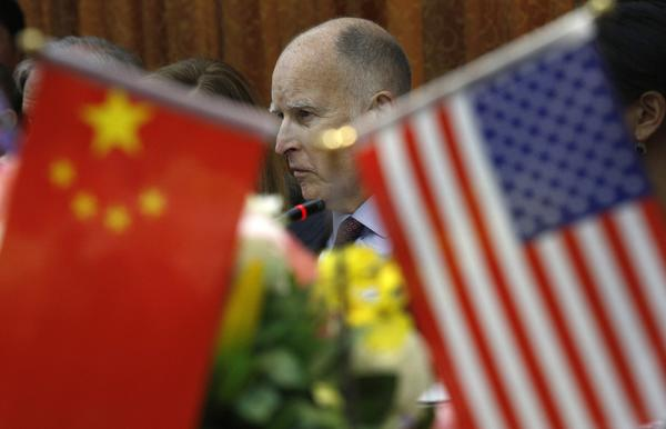 Gov. Jerry Brown participates in a meeting at the automaker BYD Co. in China
