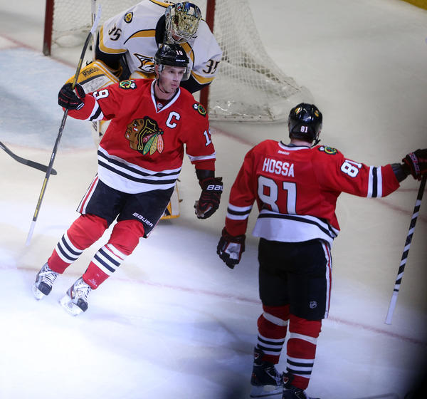 Blackhawks center Jonathan Toews, left, and Marian Hossa celebrate Hossa's game-winning goal in overtime against the Predators (Brian Cassella/Chicago Tribune)