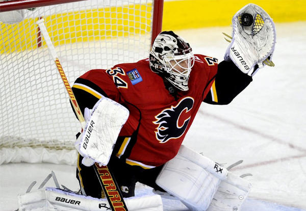 Calgary Flames goalie Miikka Kiprusoff makes a save during second period against the Anaheim Ducks.