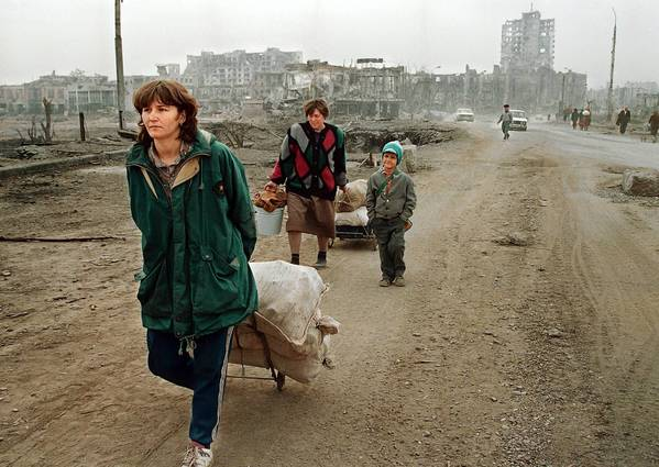 Two women pull carts in 1995 in the devastated streets of Grozny, capital of the southern republic of Chechnya. Russian forces fought a brutal war to crush separatist rebels in Chechnya.