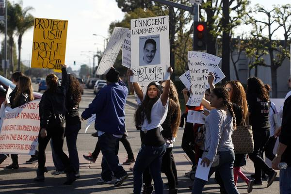 Demonstrators in Compton protest in January over the shooting death of Jose de la Trinidad by sheriff's deputies. The family is suing Los Angeles County and two deputies.