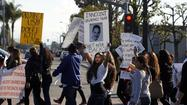 The family of an unarmed Culver City man fatally shot in the back last November filed a $15-million wrongful-death and civil rights lawsuit against Los Angeles County Sheriff's Department deputies and the county on Friday.