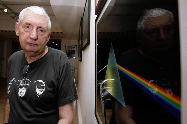 "English graphic designer Storm Thorgerson is shown in 2008 next to his iconic design for the cover of Pink Floyd's landmark 1973 album ""The Dark Side of the Moon."""