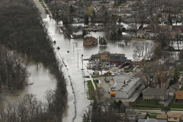An aerial view Friday, April 19, 2013 shows flooding in Des Plaines along the Des Plaines River.