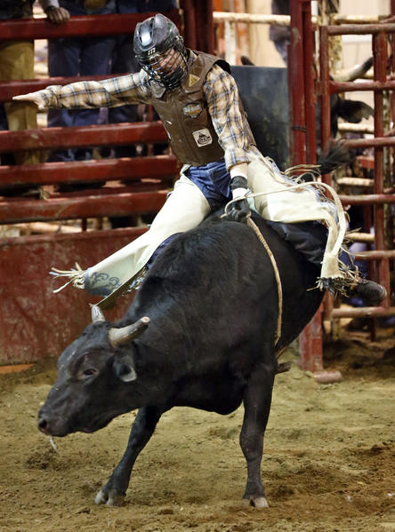 Dane Maher, of Eagle Butte, rode to a score of 83 Friday night at the Bull Riding Classic at the Holum Expo Building. photo by john davis taken 4/19/2013