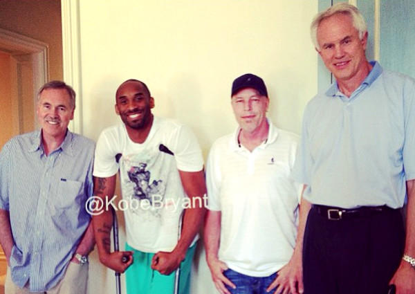 Kobe Bryant was visited on Friday by Coach Mike D'Antoni, left, Executive Vice President Jim Buss and General Manager Mitch Kupchak.