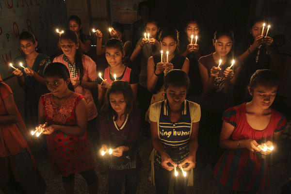 Indian schoolgirls hold candles as they pray for the speedy recovery of a 5-year-old girl who was allegedly raped in New Delhi.